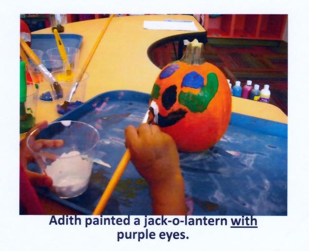 Adith painting a pumpkin at DePaul
